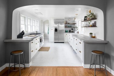 Seattle kitchen with white kitchen floor tiles and stainless steel fridge
