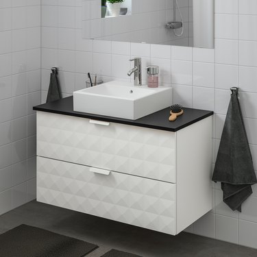 modern bathroom vanity with textured front and double drawers