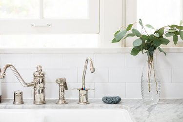 white kitchen and chrome faucet