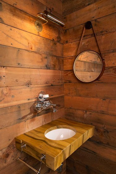 floor to ceiling reclaimed wood walls and