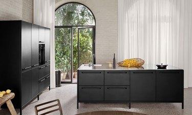 powder-coated stainless steel kitchen island in well-lit kitchen