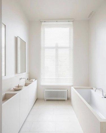 White minimalist bathrooms with radiator