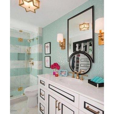 hollywood regency bathroom with blue green penny tile