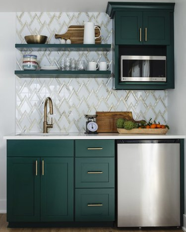 art deco backsplash with green cabinets in small kitchen