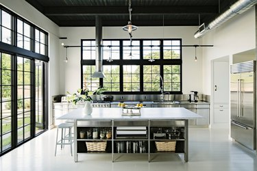 large stainless steel kitchen island with open shelving