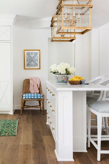 narrow kitchen island ideas for small kitchens with gold ceiling lights and white chairs