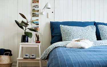 bedroom space with night stand and blue sheets