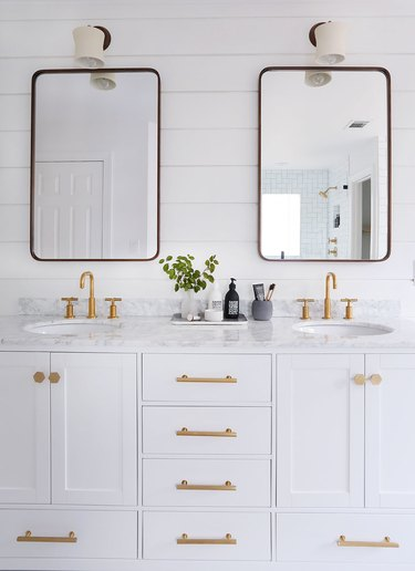 bathroom wall lighting idea with wall sconces above mirrors