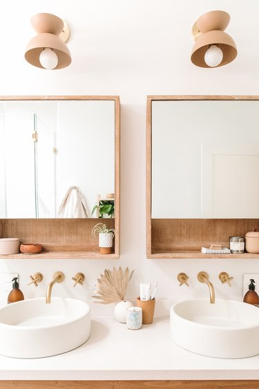nude boho bathroom wall lighting idea with double sink