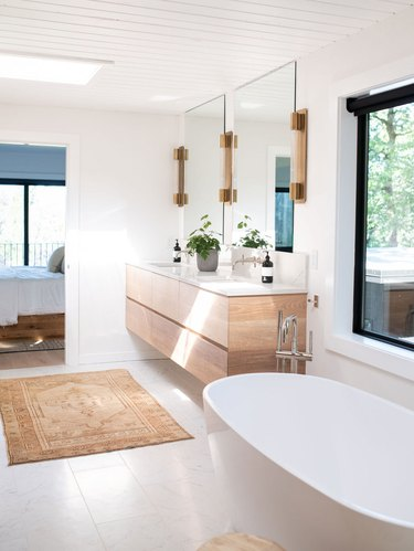 bathroom wall lighting idea with wall sconces on either side of frameless mirrors