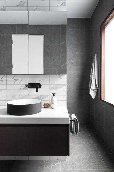 monochrome stone tile bathroom