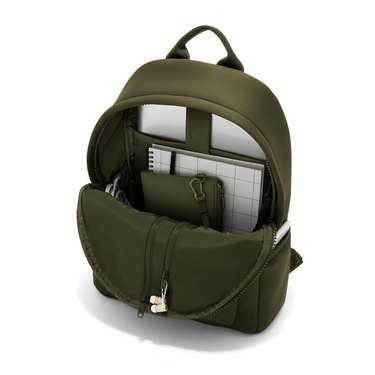 olive green backpack with pockets