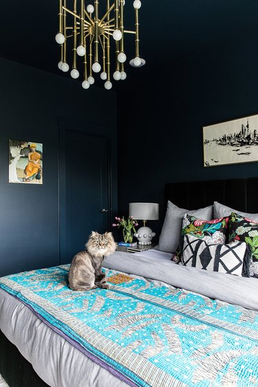 rich black bedroom with blue and gold interior accessories