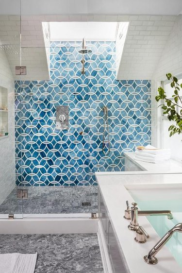 bright blue shower tile ideas in bathroom with skylight