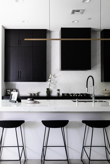 Black and white kitchen with bar/pendant light