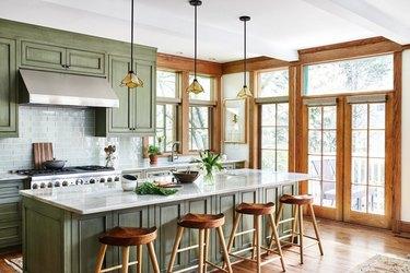 craftsman kitchen cabinets in green with subway tile backsplash