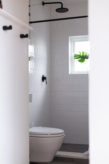 Hiding the toilet tank in the wall made more space in the bathroom,