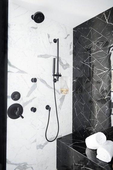 white and black marble shower tile ideas in modern bathroom