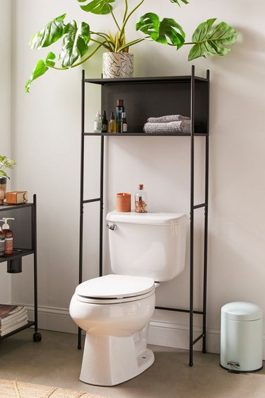 metal over the toilet cabinet with open storage cubby