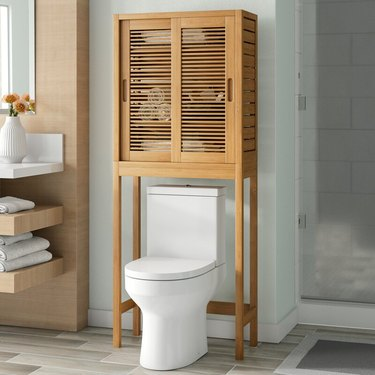 midcentury modern over the toilet bathroom cabinet