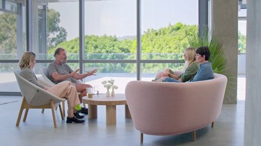 screenshot from the goop lab of sitting area with pink sofa