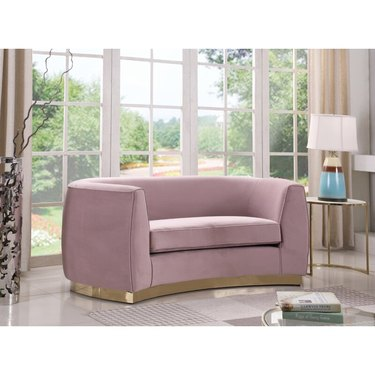 pink curved sofa