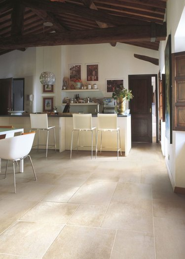 kitchen space with cream tile and bar stools