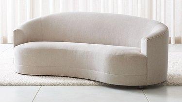 white curved sofa