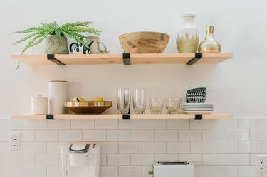 Open kitchen shelving with dishes in white kitchen