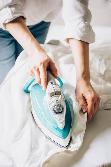 Ironing white bed sheets