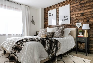 rustic bedroom with dark wood shiplap accent wall