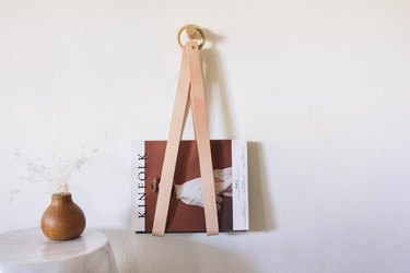 Leather and wood hanging magazine holder