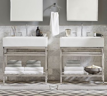 bathroom space with two rectangular mirrors and two vanities
