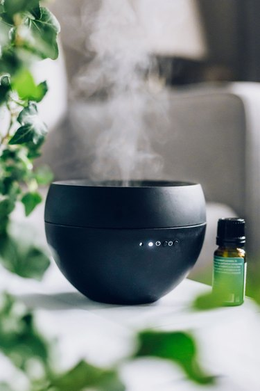 Mist coming from black essential oil diffuser