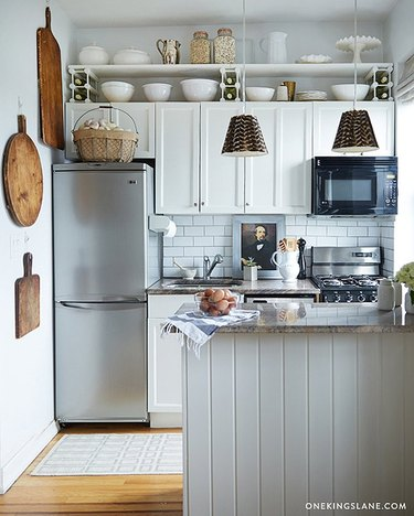 white and grey one wall kitchen with island