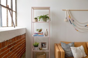 Pink IKEA shelf in boho style living room