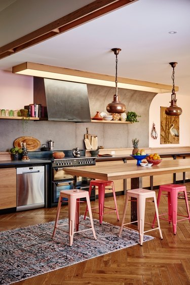 industrial meets bohemian kitchen with colourful stools
