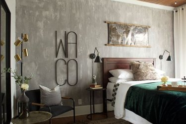rustic bedroom with textured gray accent wall
