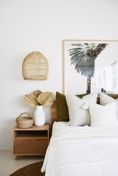 white boho beach bedroom with rattan details and beach print