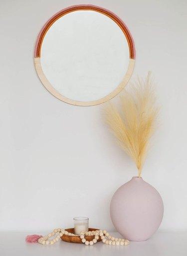 boho wall decor idea with yarn and wood mirror