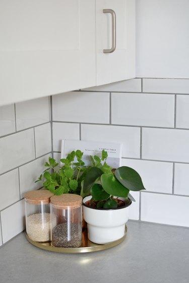 corner of concrete countertop with subway tiles