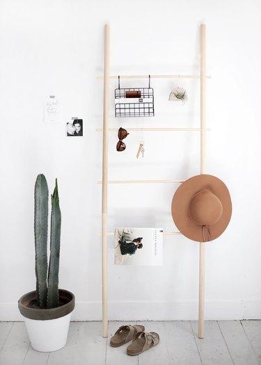 DIY wood dowel blanket rack with accessories