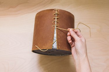 Wrapping and stitching leather onto tin planter