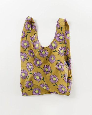 baggu reusable bag with yellow and purple flower pattern