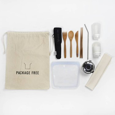 travel kit with bag and reusable items like bamboo utensils and reusable sandwich bag