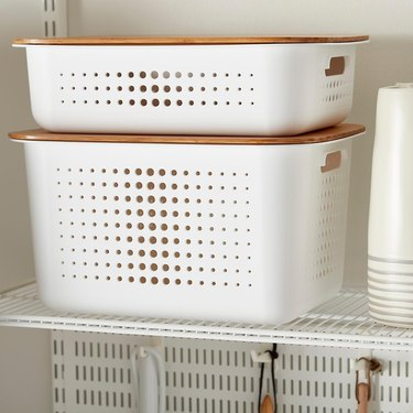 The Container Store white plastic storage bins with light wood lids and handles