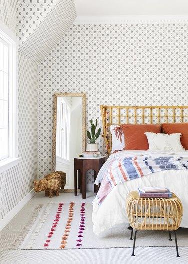 boho girls room with paisley-print wallpaper, rattan bed