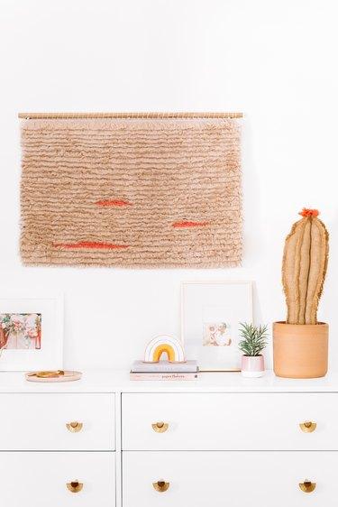 boho wall decor idea with handmade fringe wall hanging