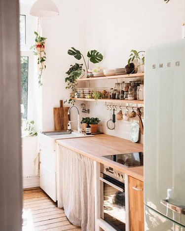 bohemian kitchen with open shelving and wood countertop