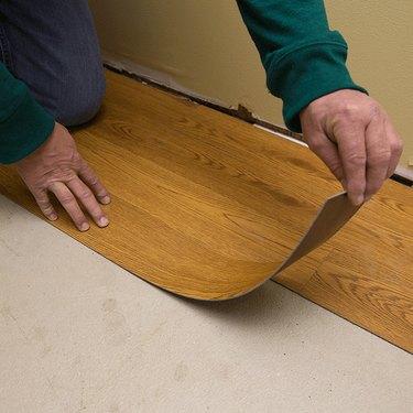 Bending vinyl plank flooring.
